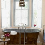 Master Bath with Copper Tub - Bianchi loves sitting in neck-high water in her 1860s zinc-lined copper tub. A vintage Chinese birdcage hung from the ceiling adds another element of quirkiness.