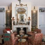 Antique Paisley in the Living Room - Four armchairs upholstered in a bold red antique paisley are clustered near the living room fireplace