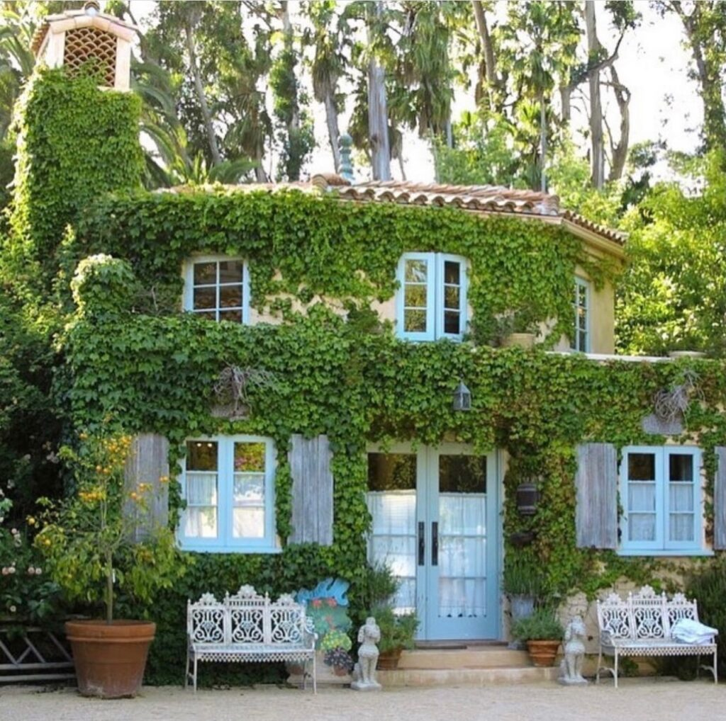 an outdoor shot of the guest house of the French Farmhouse Montecito property