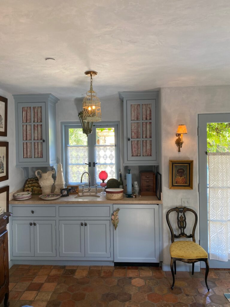 the kitchen area inside of the guest house on the French Farmhouse Montecito property